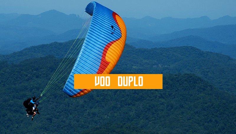 voo duplo de parapente paraglider paramotor saltar pular voar vôo duplo escola de voo livre cursos montanha aventura superação sonho de voar kite surf